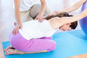 physical therapist massaging hertford